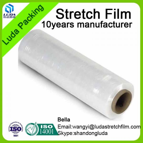 Hot plastic packaging film wrapped around the transparent film